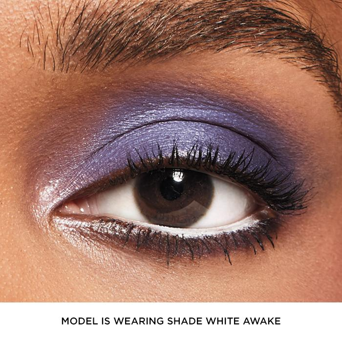 Model wearing white awake Glimmersticks eye liner by AVON