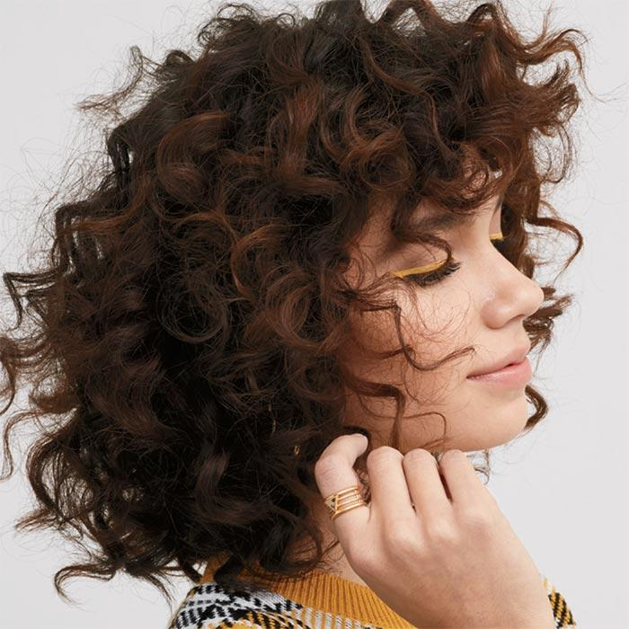 curly haired model using Elastine Propolithera Volume Mousse